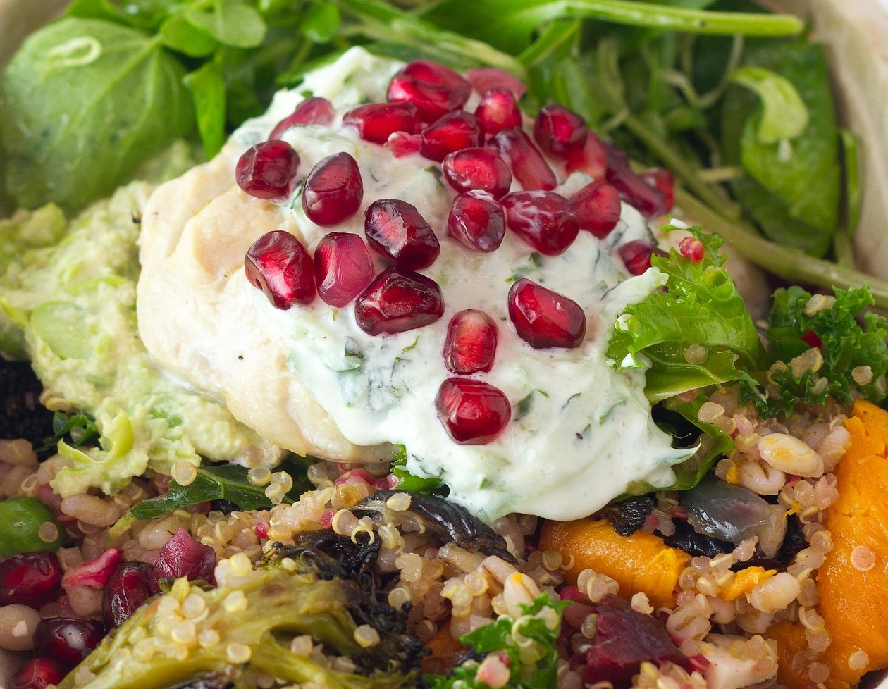 Seeds are popped from our stack of pomegranates when needed. Scattered over handmade mint & cucumber dressing sitting on top of roasted veggies and homemade edamame hummus.
