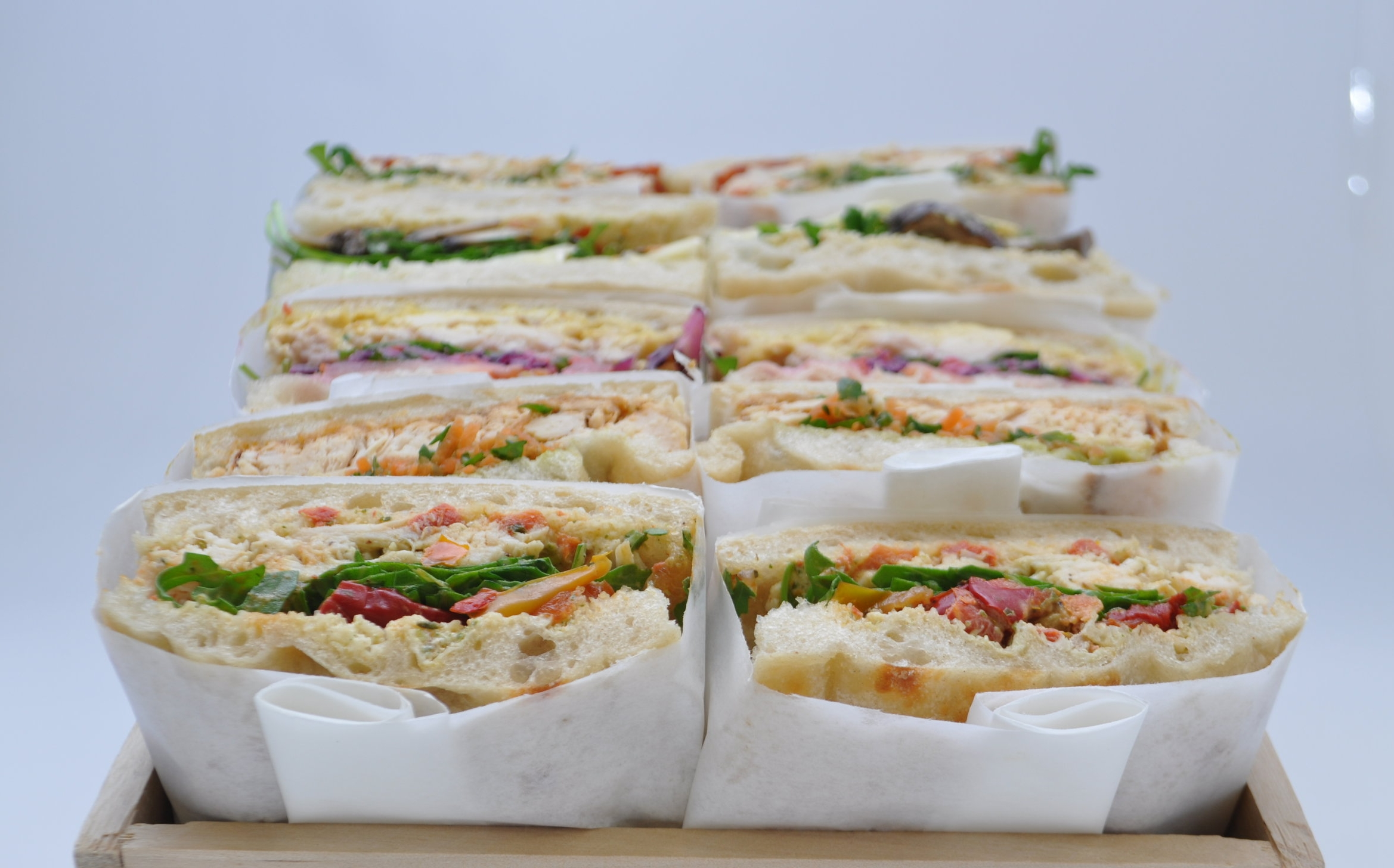 CATERING   Each order is custom made on the day required to ensure the freshest possible experience (ask your current supplier whether they do that).  Sandwiches, wraps and salads with a full range of sweet & savoury sides.