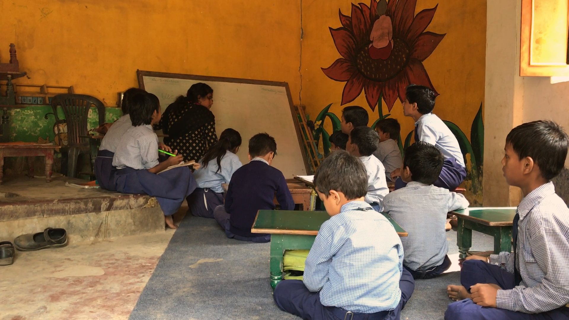 Pooja teaching her Class 2 students in the shed