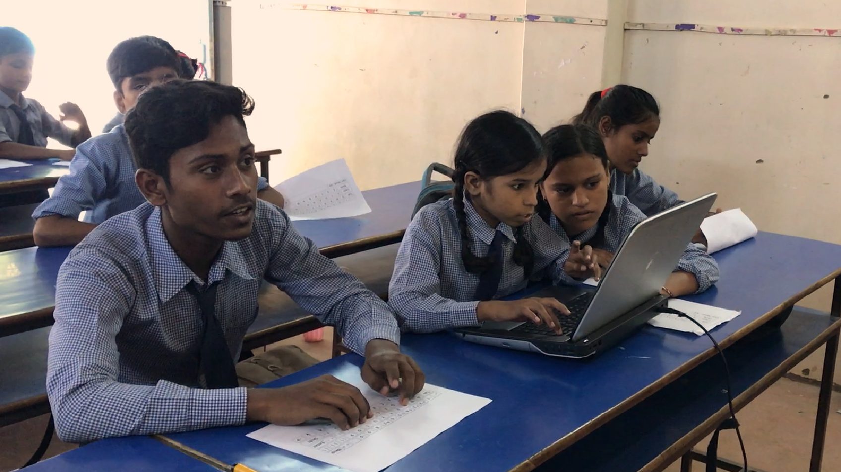 Our Class 5 students in Computer Skills class - students practice on paper keyboards awaiting their turn