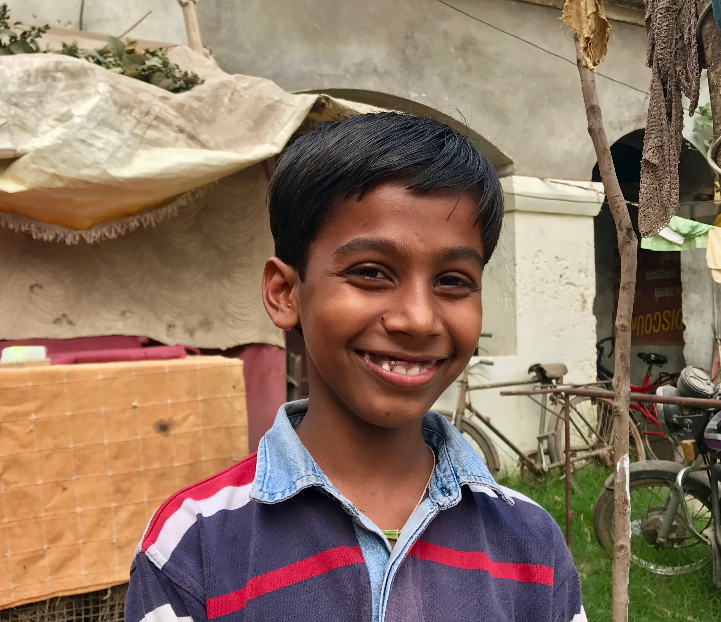 """""""My name is Akash. I was 5 years old when I joined school. I go to school everyday because I get to learn new things and when foreigners come from afar and teach me things, it's fun and intriguing. At Anjali, I learned to always study well and be good to others. I learned not to steal nor abuse anyone. I learned to solve problems and English too and many other things. I also love to type and draw on the computer. I can do anything for my education. My mom and my dad are both very hard-working. I get my courage from my parents. My mom always keeps me motivated and gives me hope. I don't want to do anything for myself. As soon as I become something, I won't let my parents to continue to live and work in these conditions. I want to keep my books safe and close to me. I can never give up my studies. In 10 years, I will be an engineer. I want to design and create self-driving cars and robots."""""""