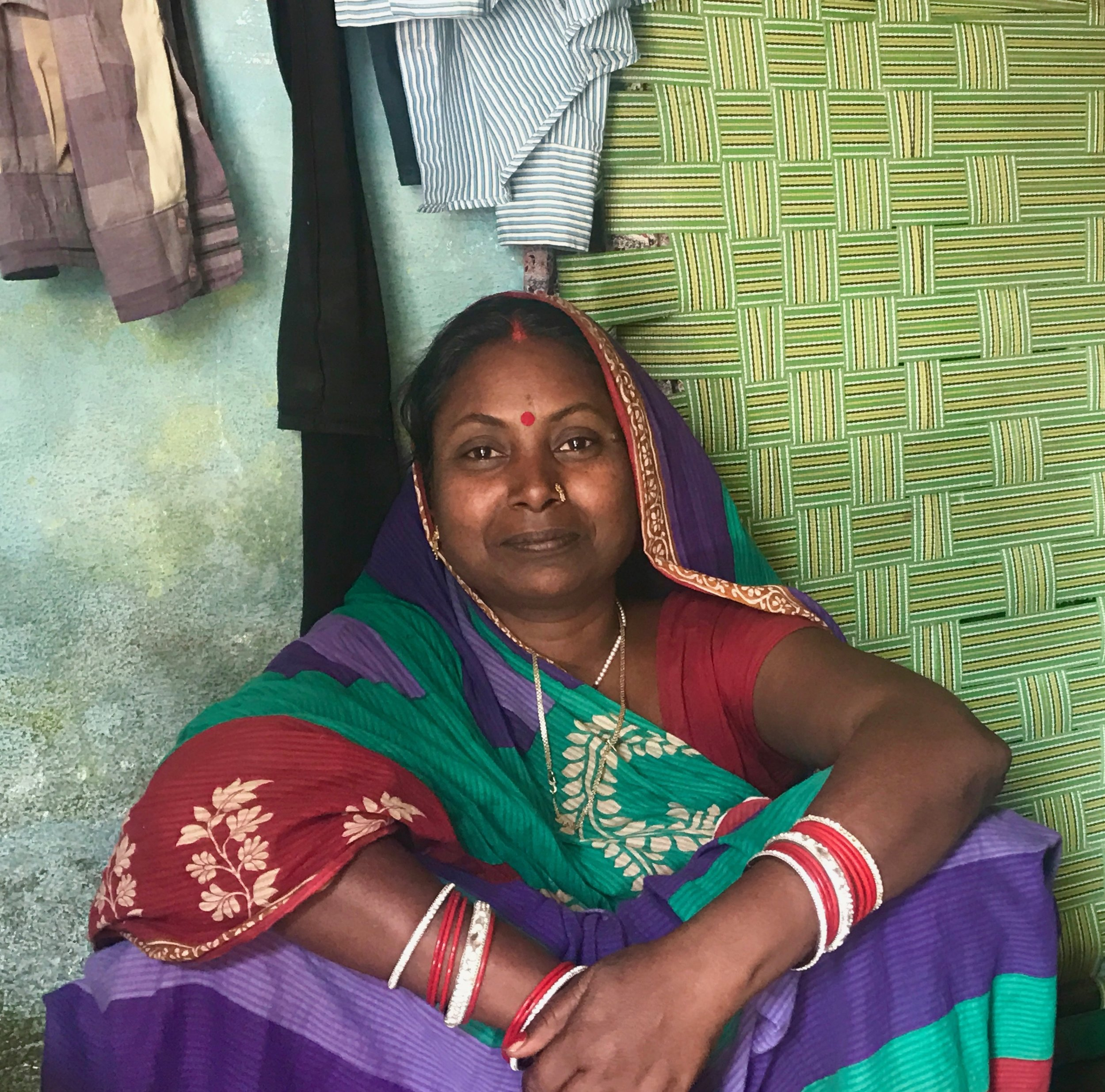 """""""We are from Ballia. We moved here 10 years ago. My husband was not well. We came to Varanasi for his medication, and spent what little money we brought with us from our village. So for 3 years, I worked as a maid in different houses so my husband could receive his treatment. For 3 years, I was the woman of the home. I financed everything and slowly his health improved. Both of us started working, and when we were able to save some money, we sent our children to school. When he was not well, I never lost hope. I prayed that I would work to feed my husband and children. I would never mistreat my husband nor let him feel dejected. I would tell him not to cry. He used to cry a lot, and still I did not lose hope. I had a lot of power. I was never unhappy. I always told him not to worry. I told him that I would always be with him."""""""