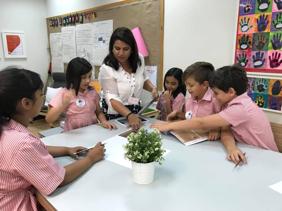 Students at Dubai English Speaking School intrigued by photo cards used as teaching resources -History of the UAE through Archaeology workshop.