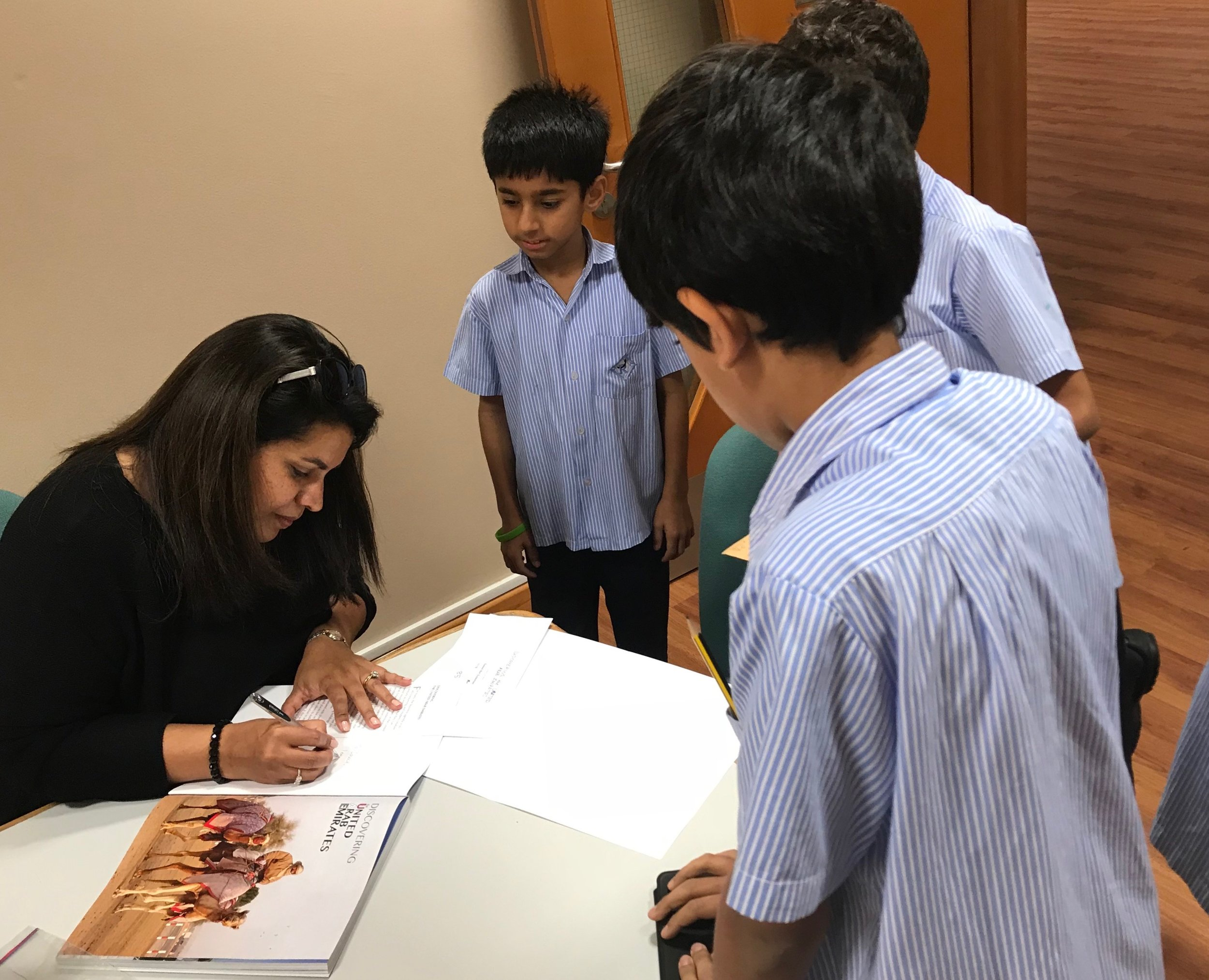 Signing books for students at Rashid School for Boys