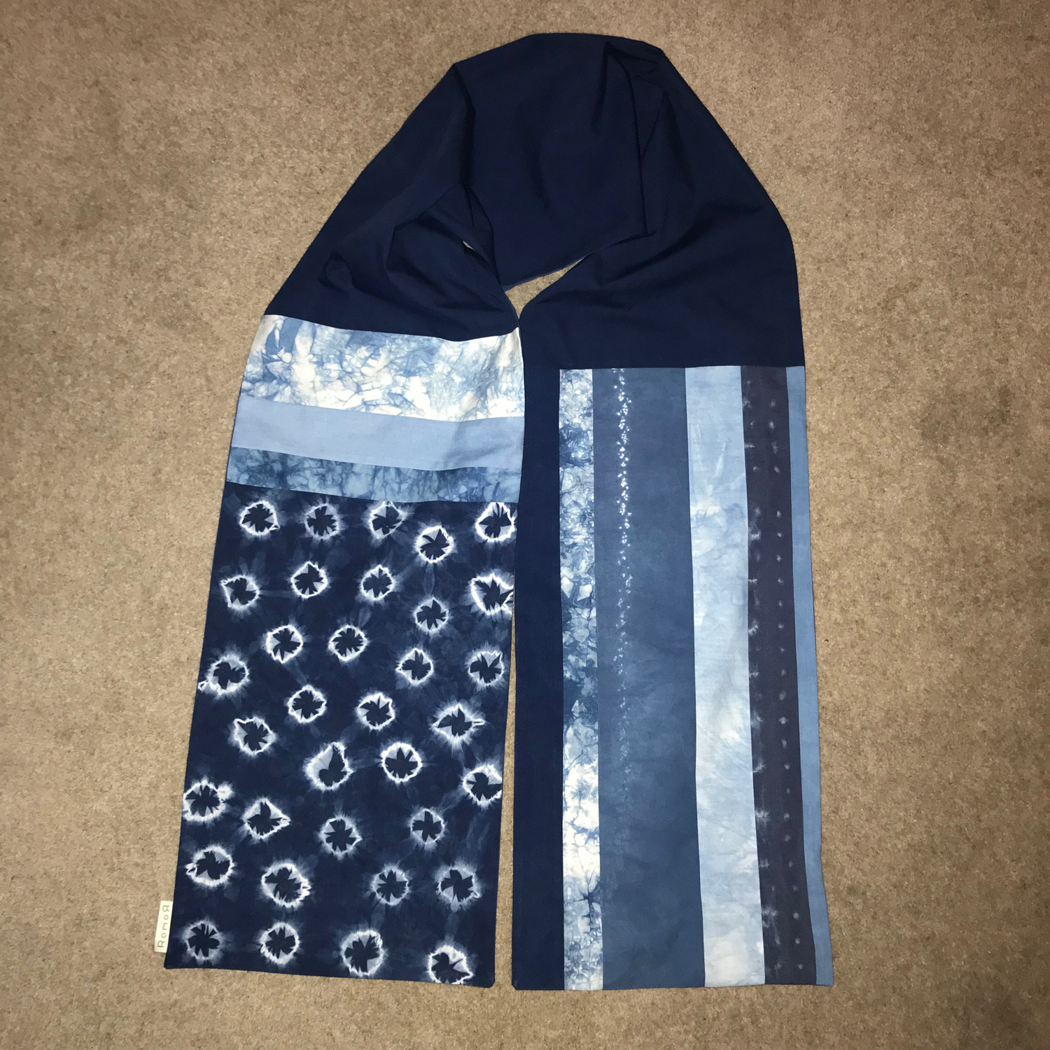 This is a shibori stars and stripes cotton patchwork scarf. Its been sold though, sorry!