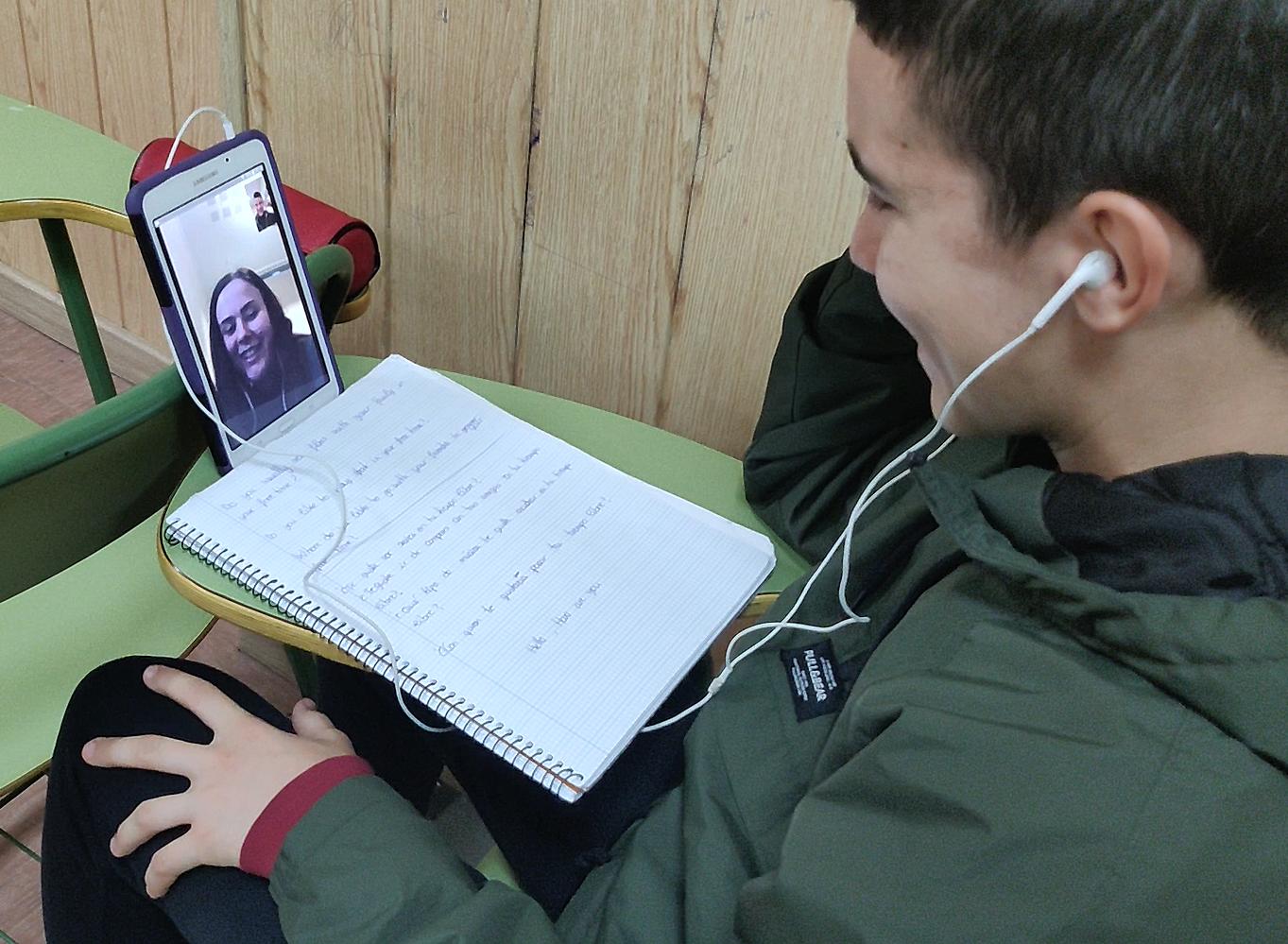 Spanish student videochatting his Norwegian partner student at his school in Málaga, Spain