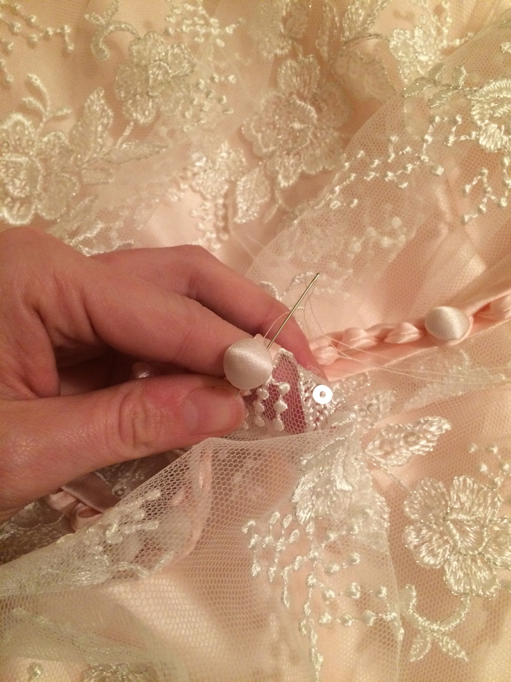 Handmade wedding dress back buttons.jpg