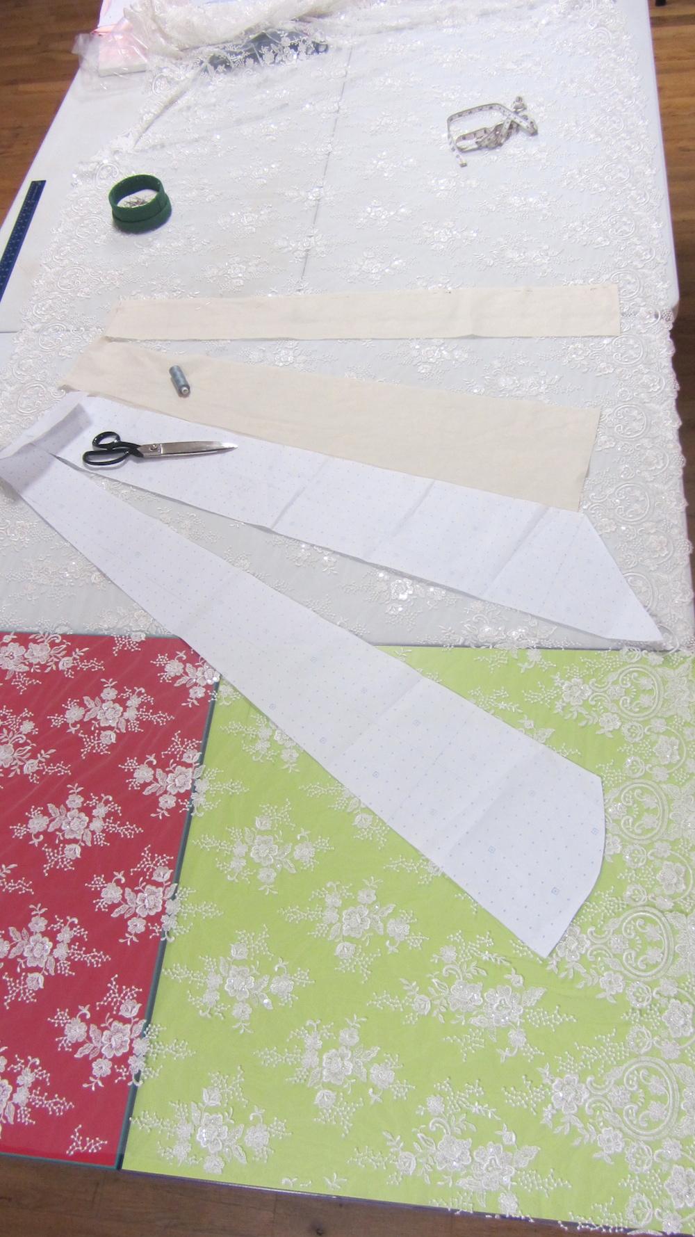 Handmade wedding dress shellet lace cutting out.jpg