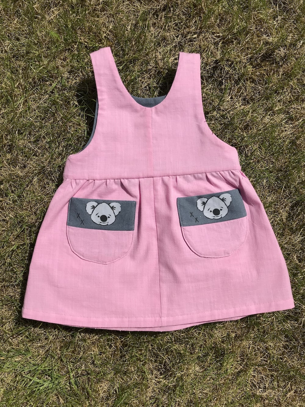 Puperita Lil Critters Pinafore Dress in pink .jpg