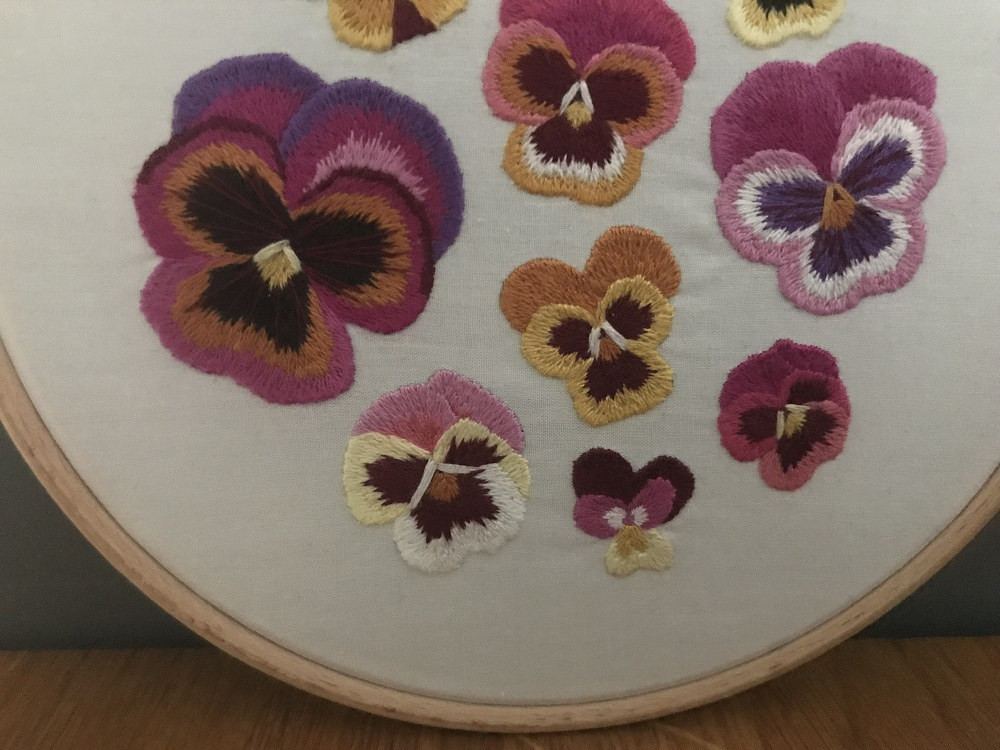 Multiple pansy embroidery using long and short stitch.jpg