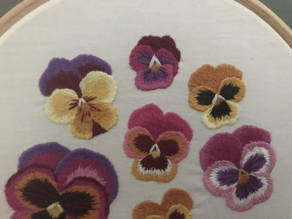 Pansy needle painting hoop art.jpg