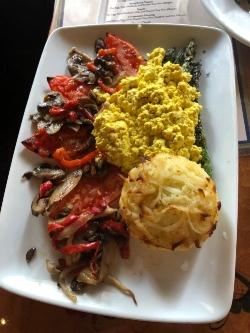 Akershus vegan platter featuring grilled vegetables, tofu scramble, and a hash