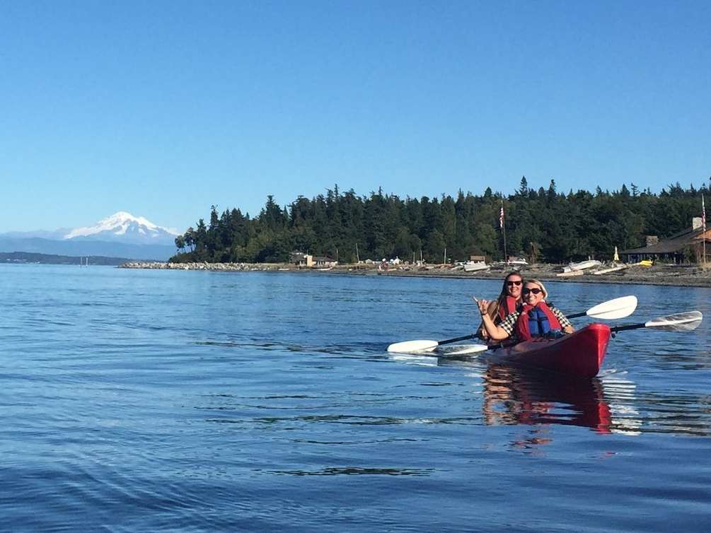 My mother and I in a tandem kayak in the Salish Sea, 2015