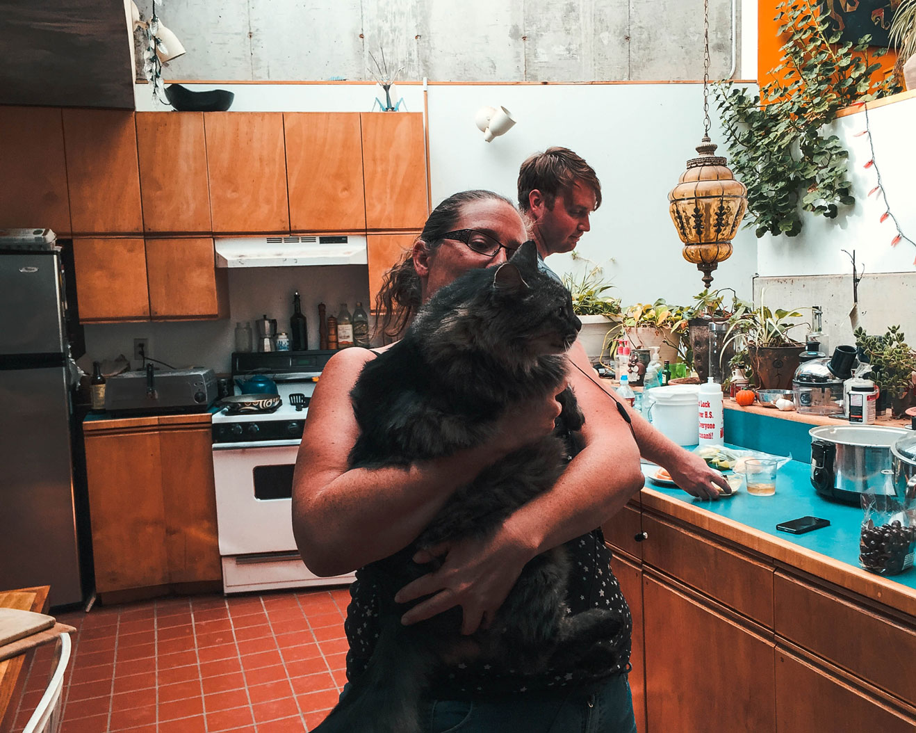 Workshop Coordinator Mel with her cat in one of the larger Arcosanti living spaces