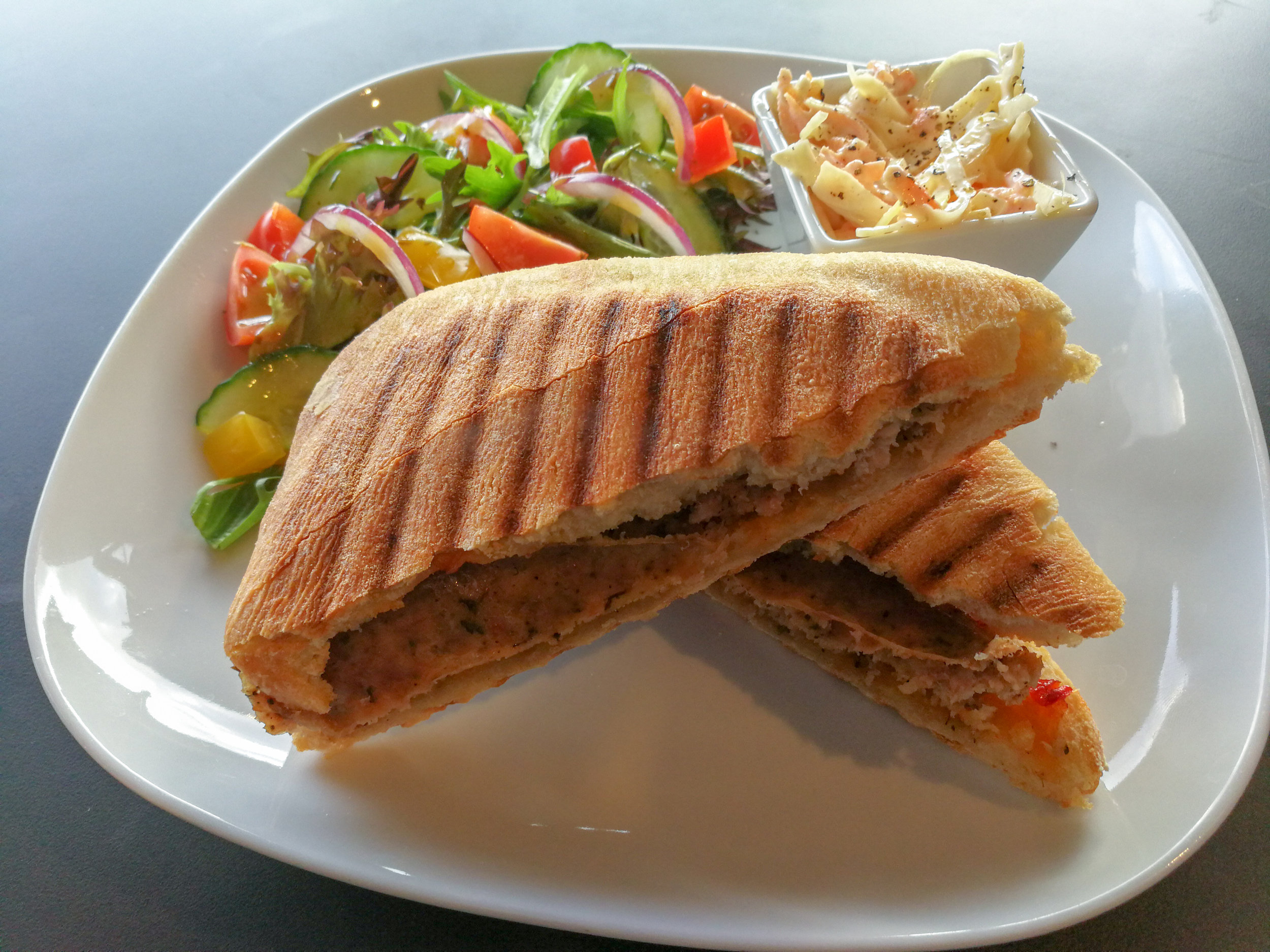 Paninis - Served on a quality ciabatta, our paninis are made fresh to order and are accompanied with a dressed mixed leaf side salad and a portion of homemade creamy coleslaw.