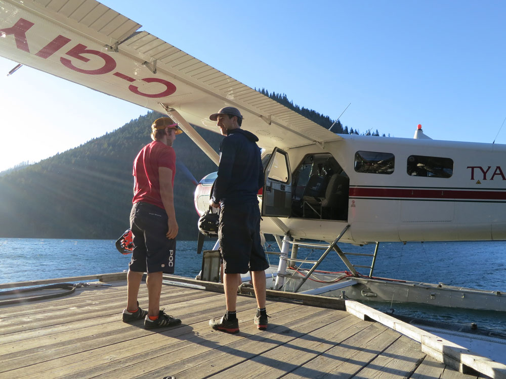Loading up on the dock. Four bikes and five people got into that little plane!