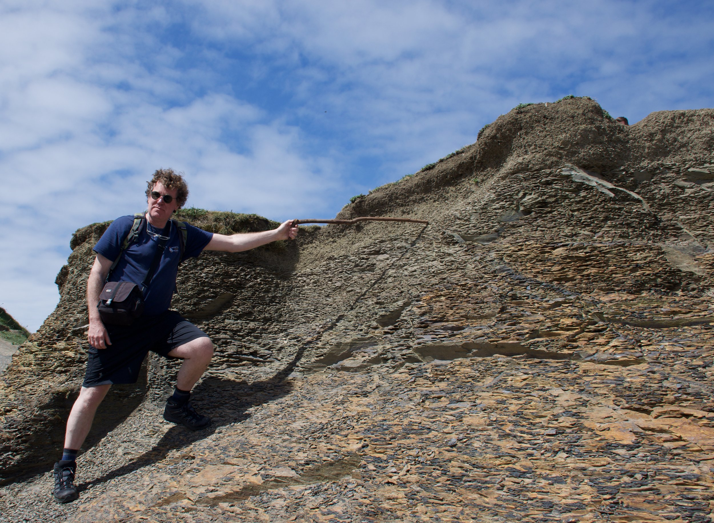 Scott explaining rock layers at the Cliffs  Photo by Susan Izard
