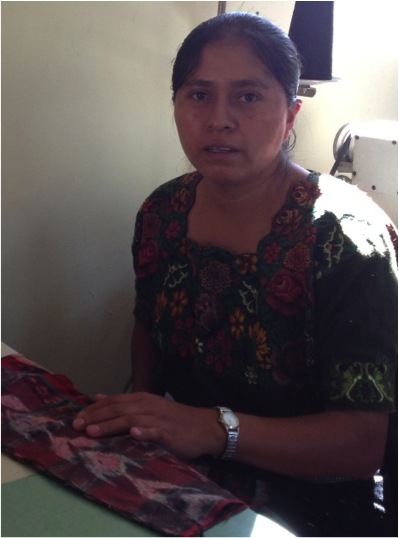 Juana Méndez Saquiy - Juana learn to sew 2 years ago and now makes wonderful products from upcycled traditional Guatemalan materials (jaspe) for Manos Cruceñas Artisan Store & ixöq. Juana had always dreamed of working with artisanal accessories and she's now very happy to have achieved that dream. Juana is 33 and married with two children. Juana wanted to get a good education but was unable to continue with school and instead married when she was 19. Until the past two years she had not worked outside the home but is now feels confident in herself because she is generating her own income to help support her family and kids' education.