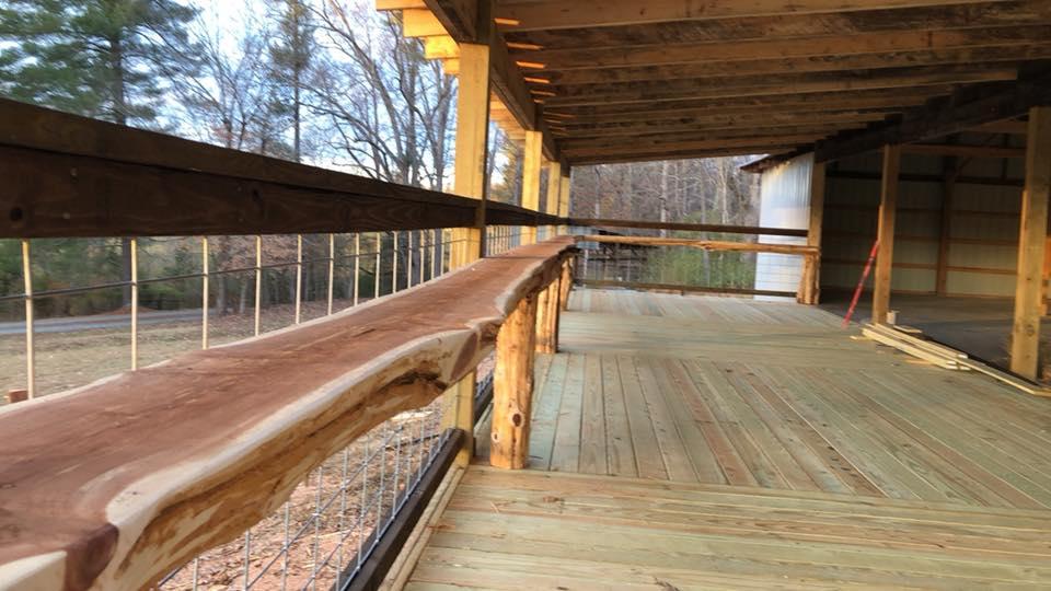 cedar bar on porch of reception barn