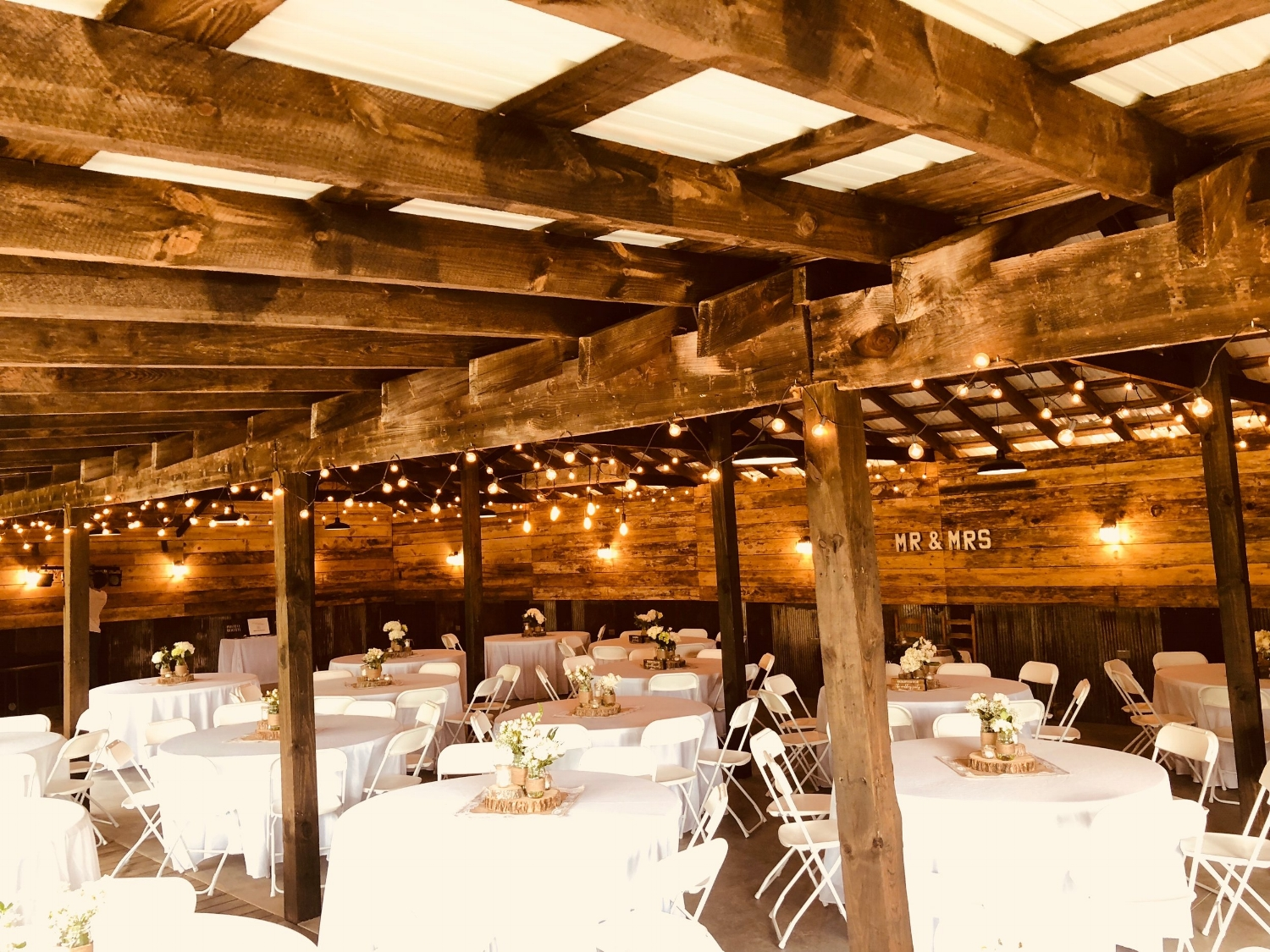 wedding reception barn at the historic venue at old holler farm in rural hall, nc