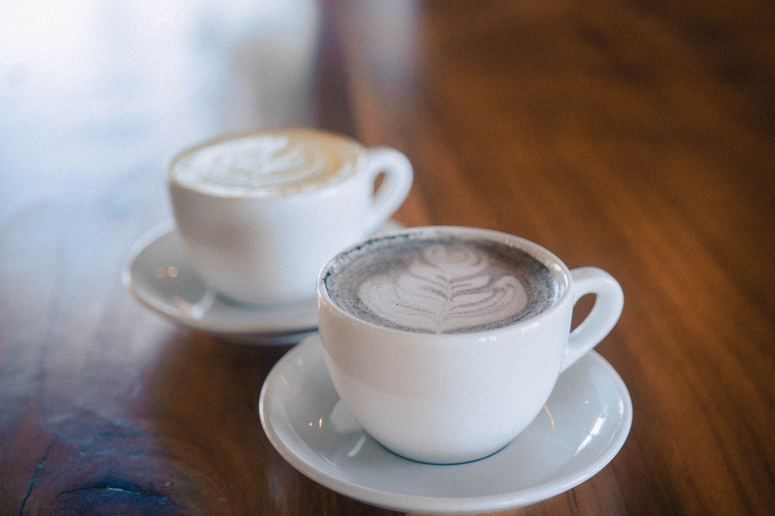 Two_white_cups_and_saucers.jpg