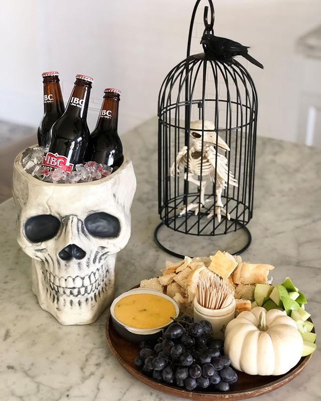 Sharing a Halloween tradition!🎃 Every year I make this cheese fondue along with sloppy joes or chili. We get so many friends and family members coming over to trick-or-treat in our neighborhood and I love providing a fun spooky spread and a hot drink for the road. This fondue is so yummy and so easy to make! Hope you enjoy! 🎃🧀🥖 (we repurposed the little vintage match jar for a toothpick holder🧐🙌🏼) #cheesefondue #halloweentradition