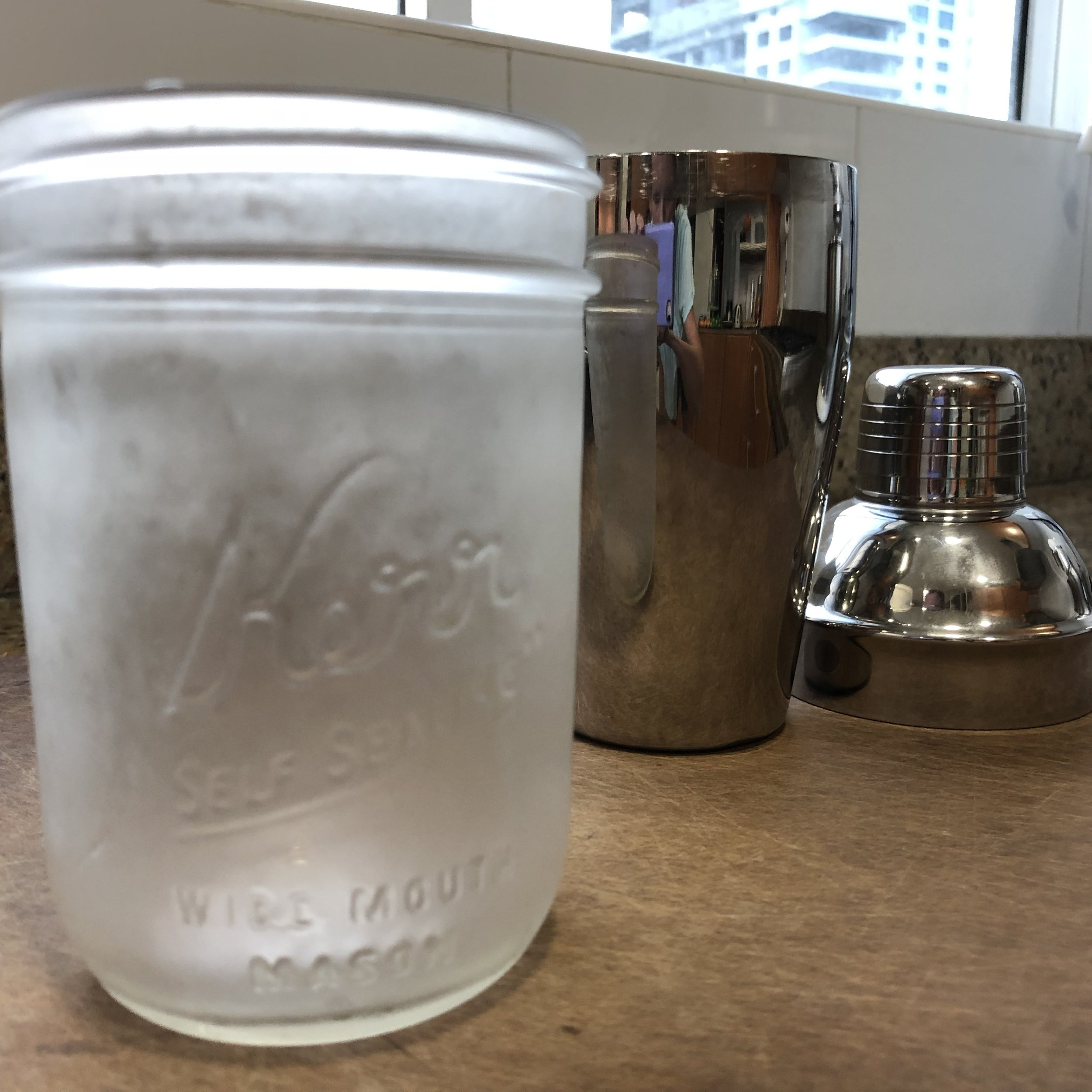 Drink shaker and frosted Mason jar. -