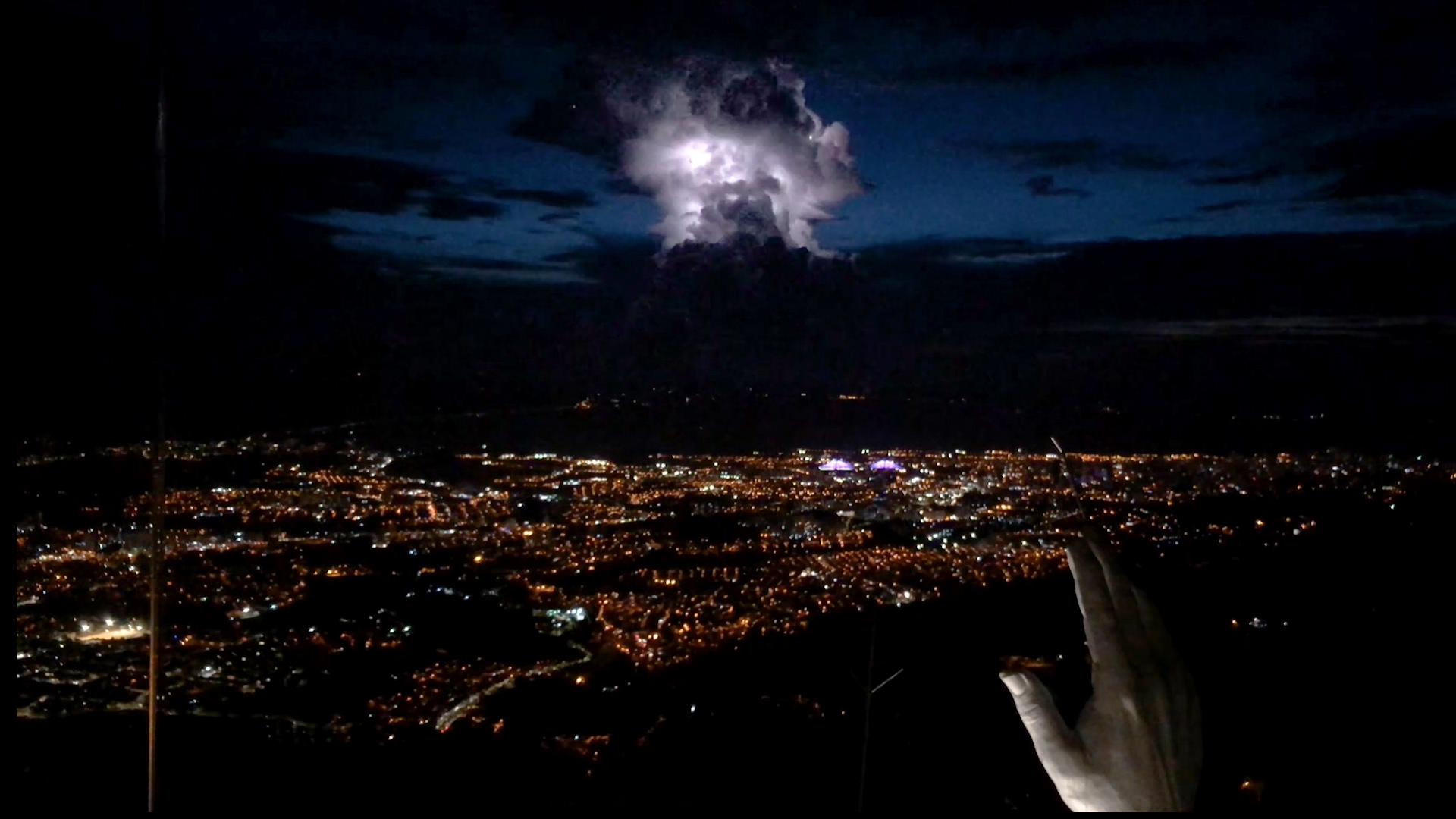 View from the top of the Christ statue at Ecoparque Cerro del Santísimo during a lightning storm.