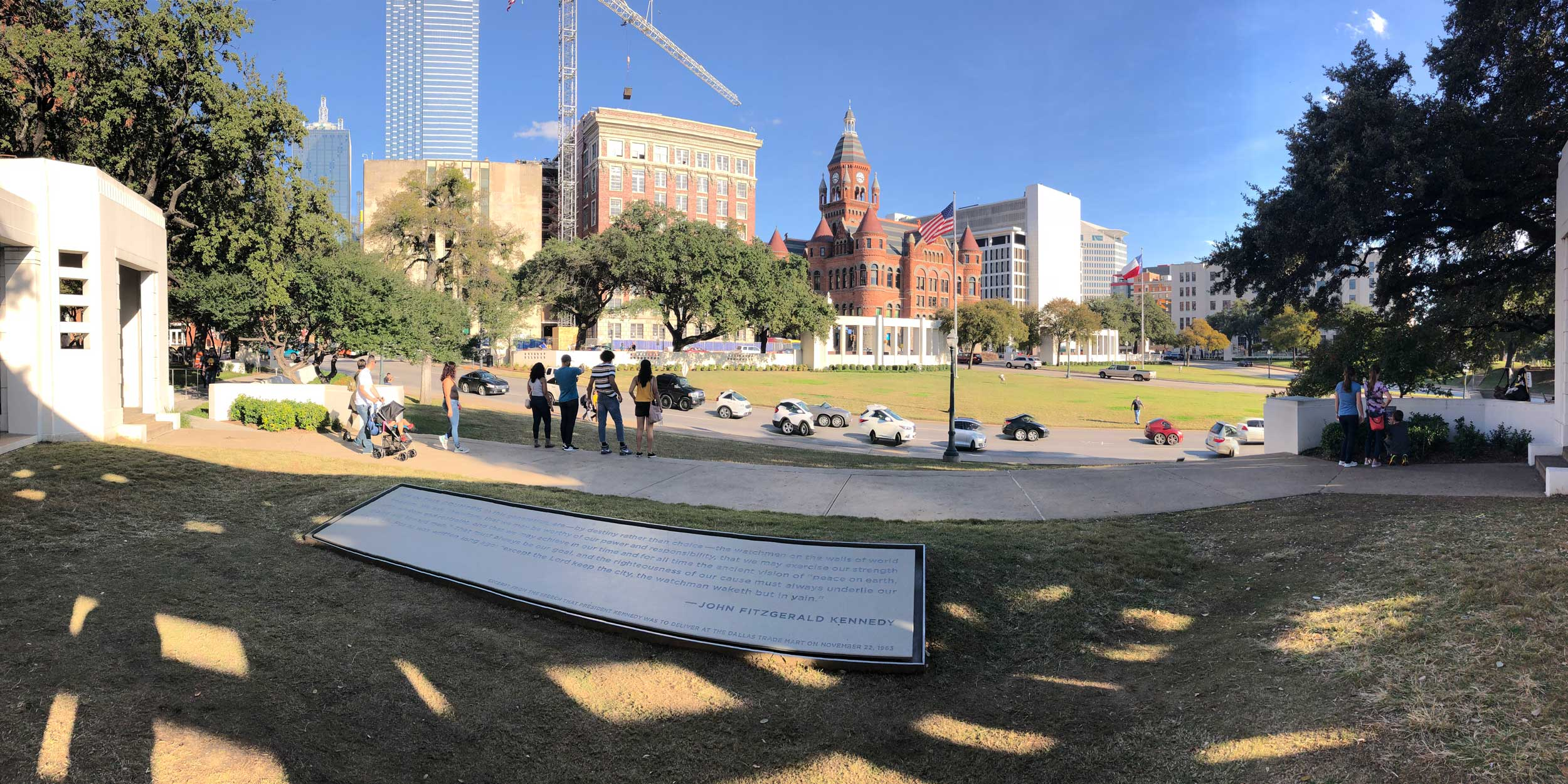 The grassy knoll at Dealey Plaza where President John F. Kennedy was shot in 1963. The plaque commemorates the speech he was on his way to give when he was shot.
