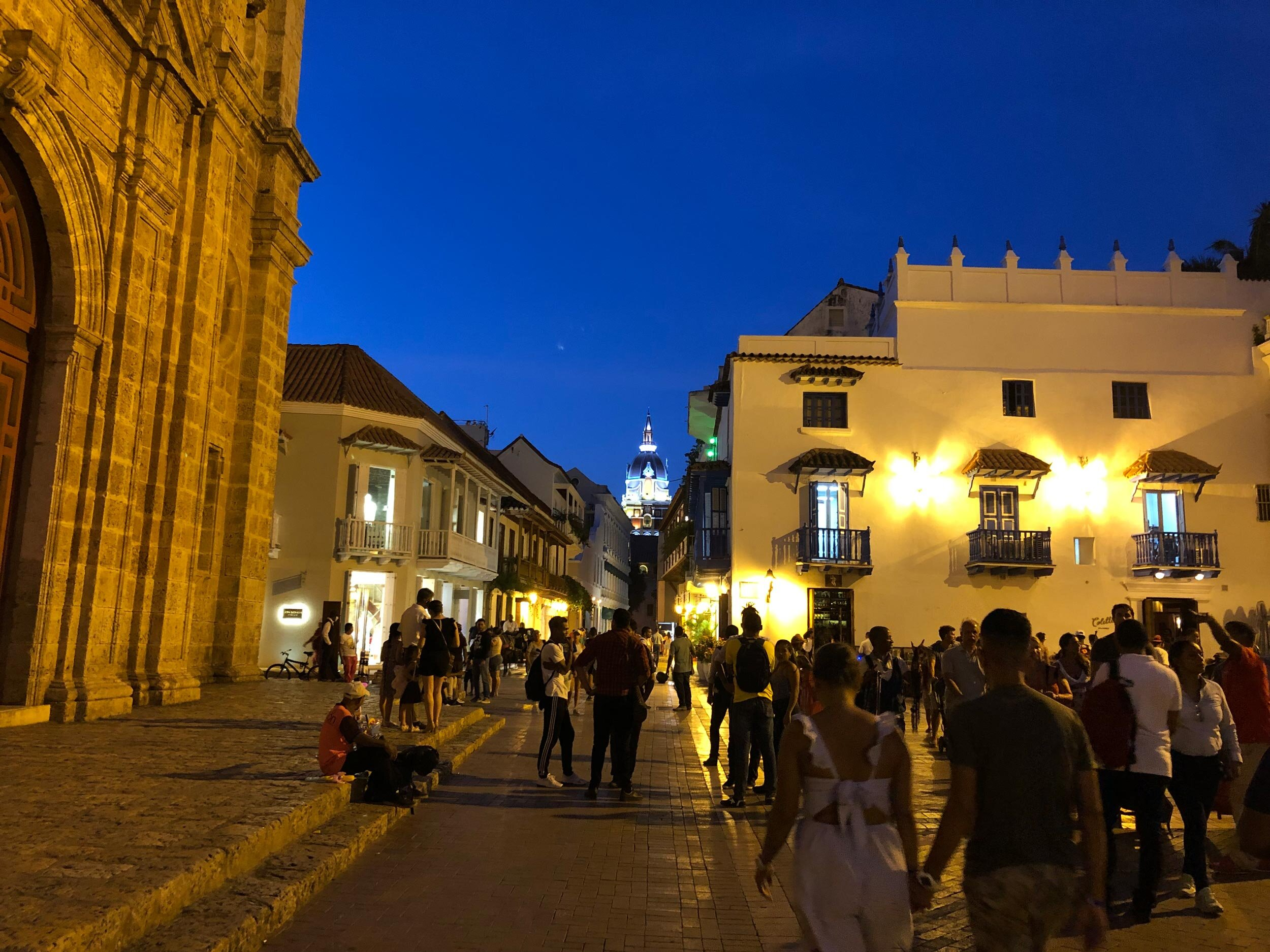 The view from Plaza San Pedro Claver looking towards the Cathedral lit up at night.