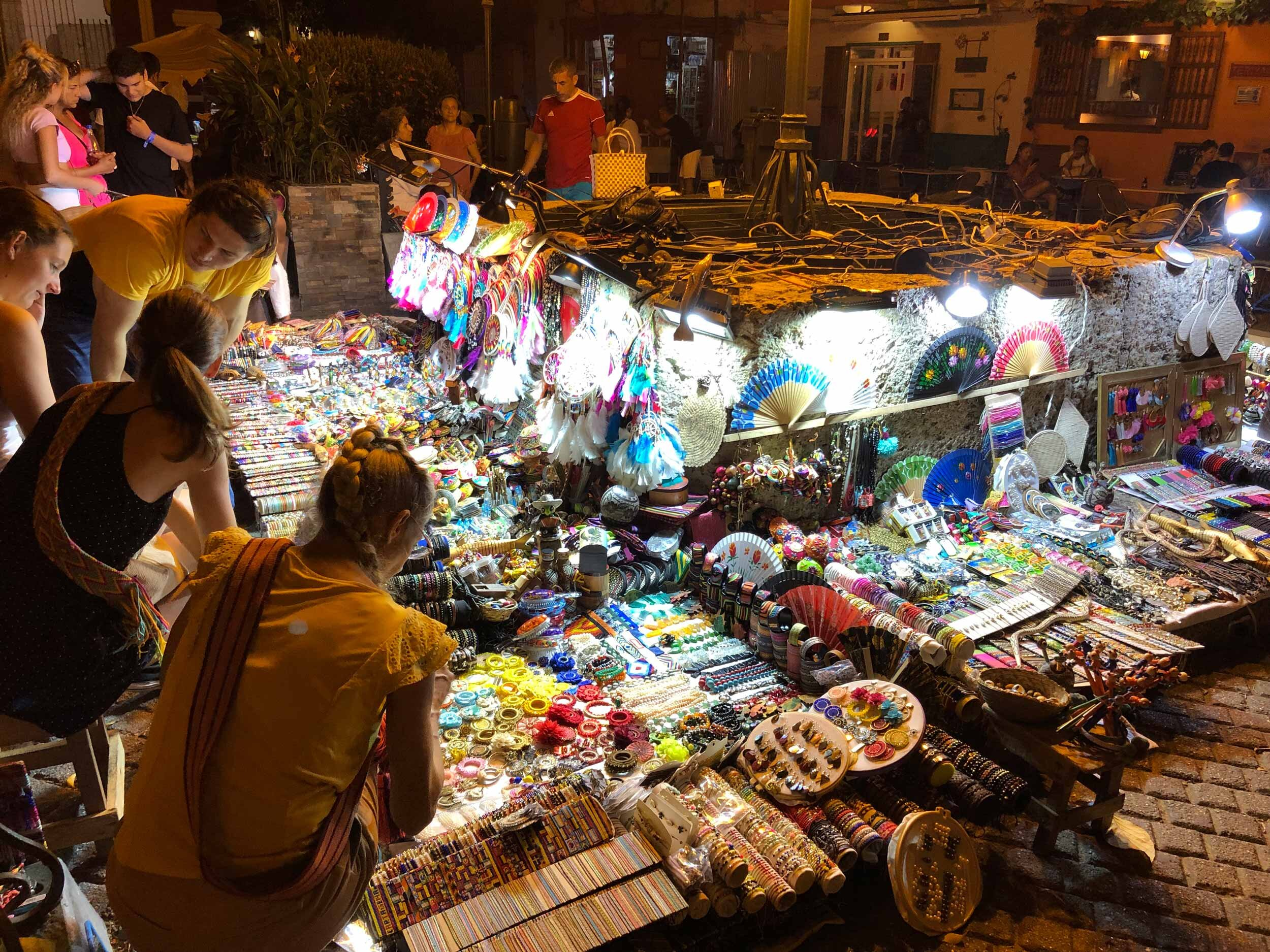 Plaza de San Diego is full of vendors selling hand made bracelets and other treasures after dark.