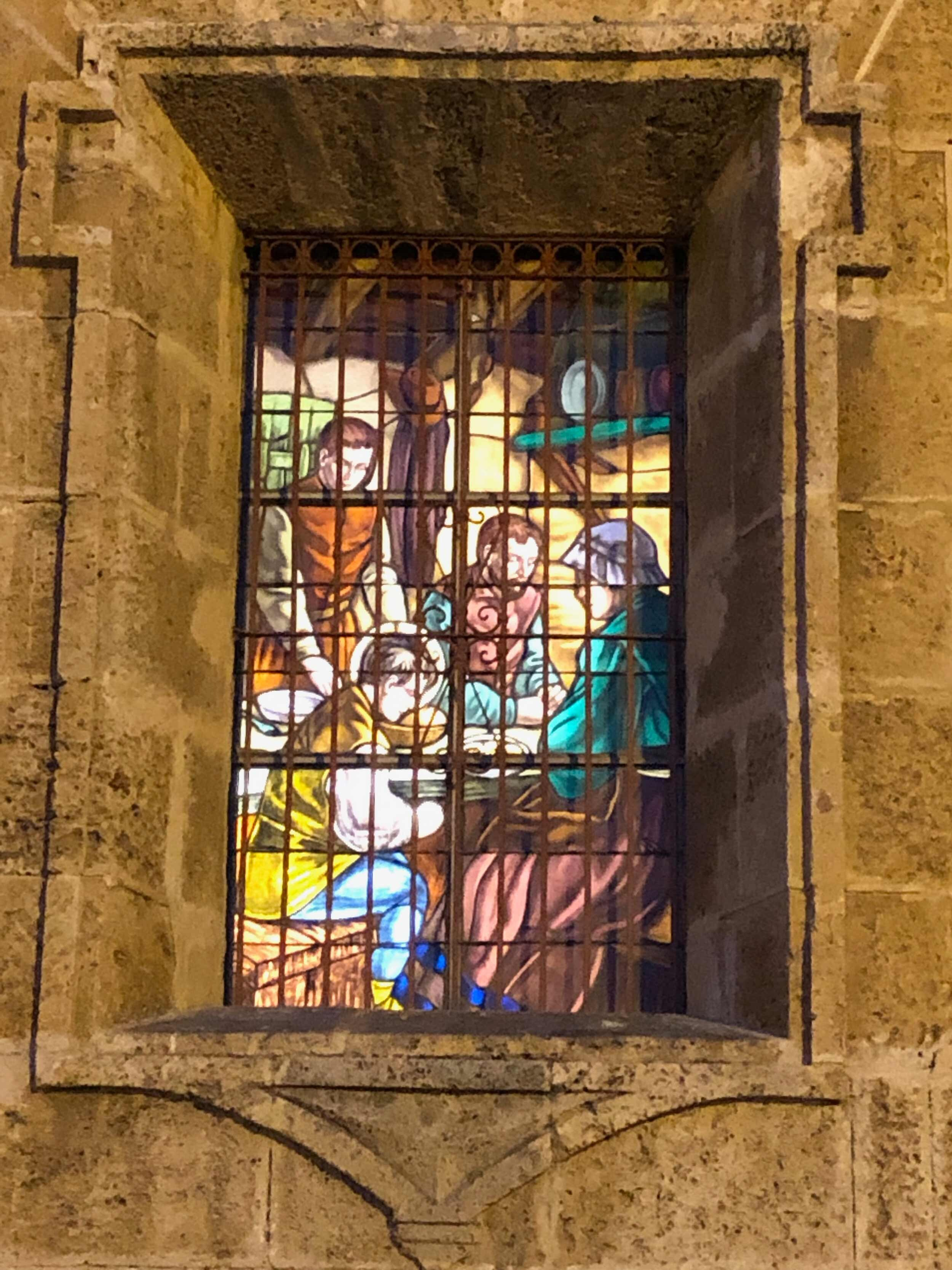 One of the stained glass windows at San Pedro Claver Church depicting the saint's life
