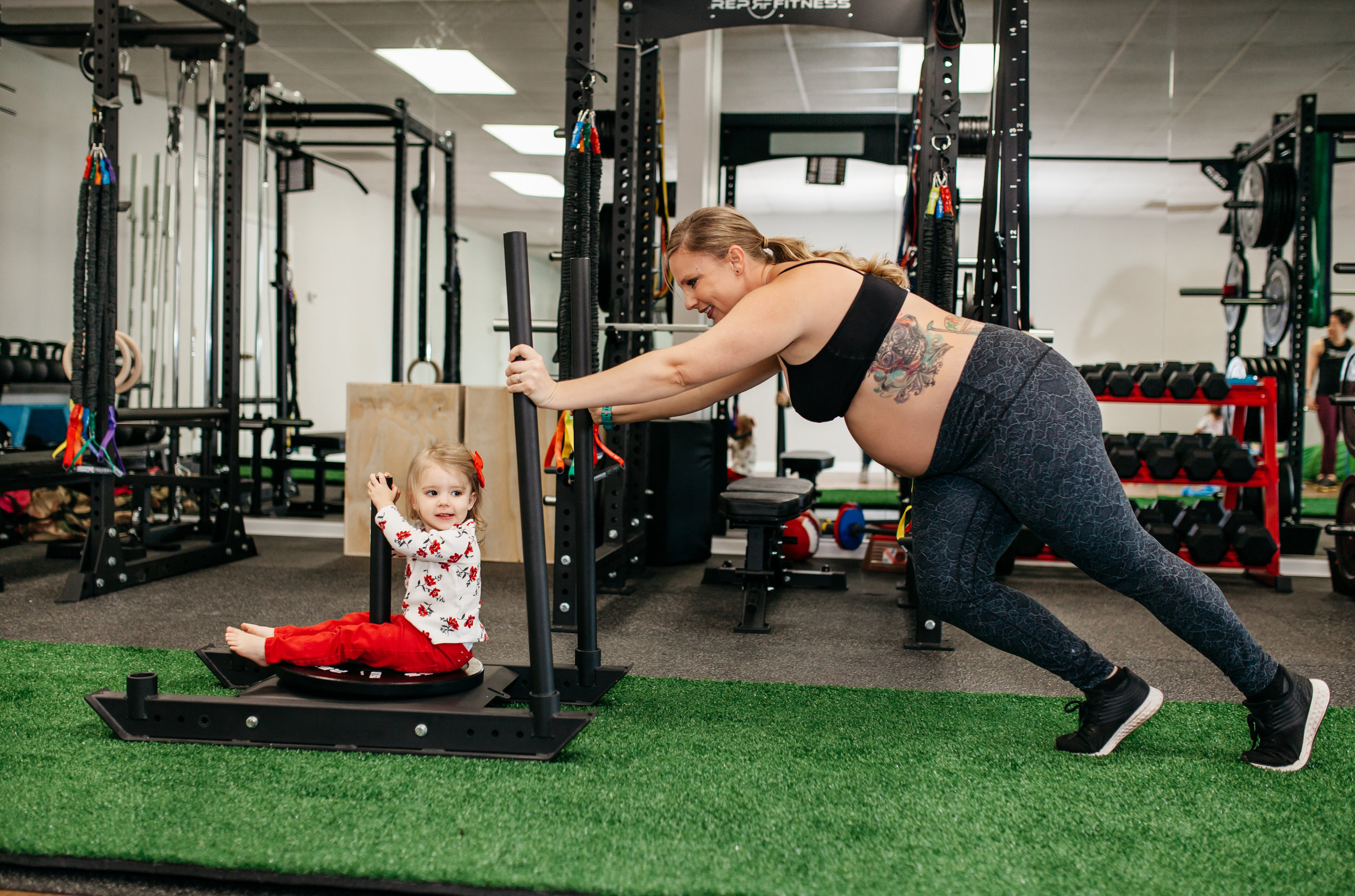 BABIES AND CHILDREN WELCOME - We work together to manage the children during workouts. Some days we babywear, some days we push strollers in circles, and some days they play quietly together in a corner. We welcome you as you are, and that includes your little ones!We have an area set aside in the gym that is for the children to play in, filled with toys, baby swings/bouncers, and walkers.