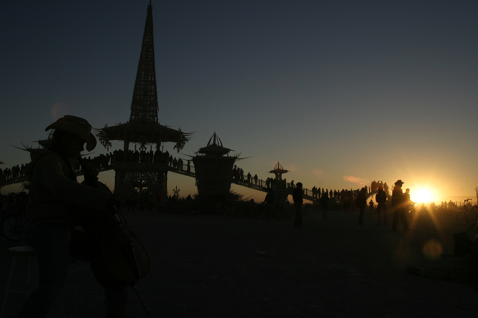 Natalie Nguyen (1/2 Vietnamese, 1/2 Irish) playing cello on Sunday sunrise at the temple, hours before it (the temple) was to be set on fire. BM-2004