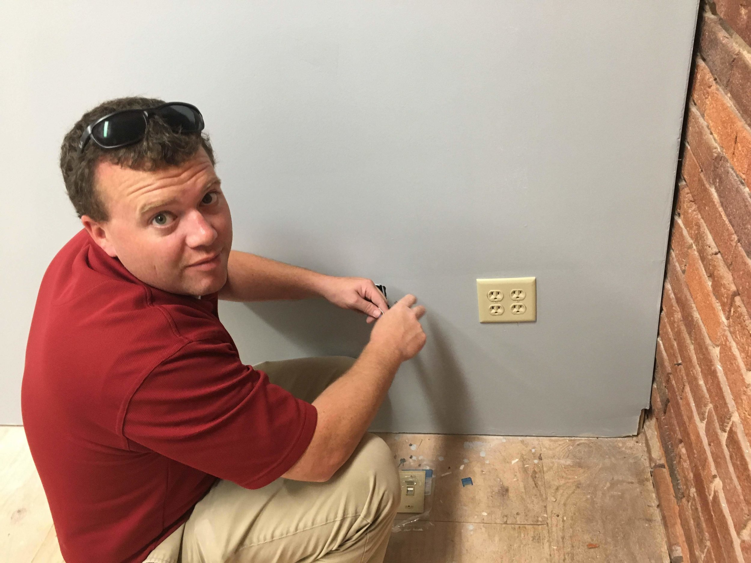 Our Lead Tech, Steven, terminates a Cat6 cable for a client's new office.