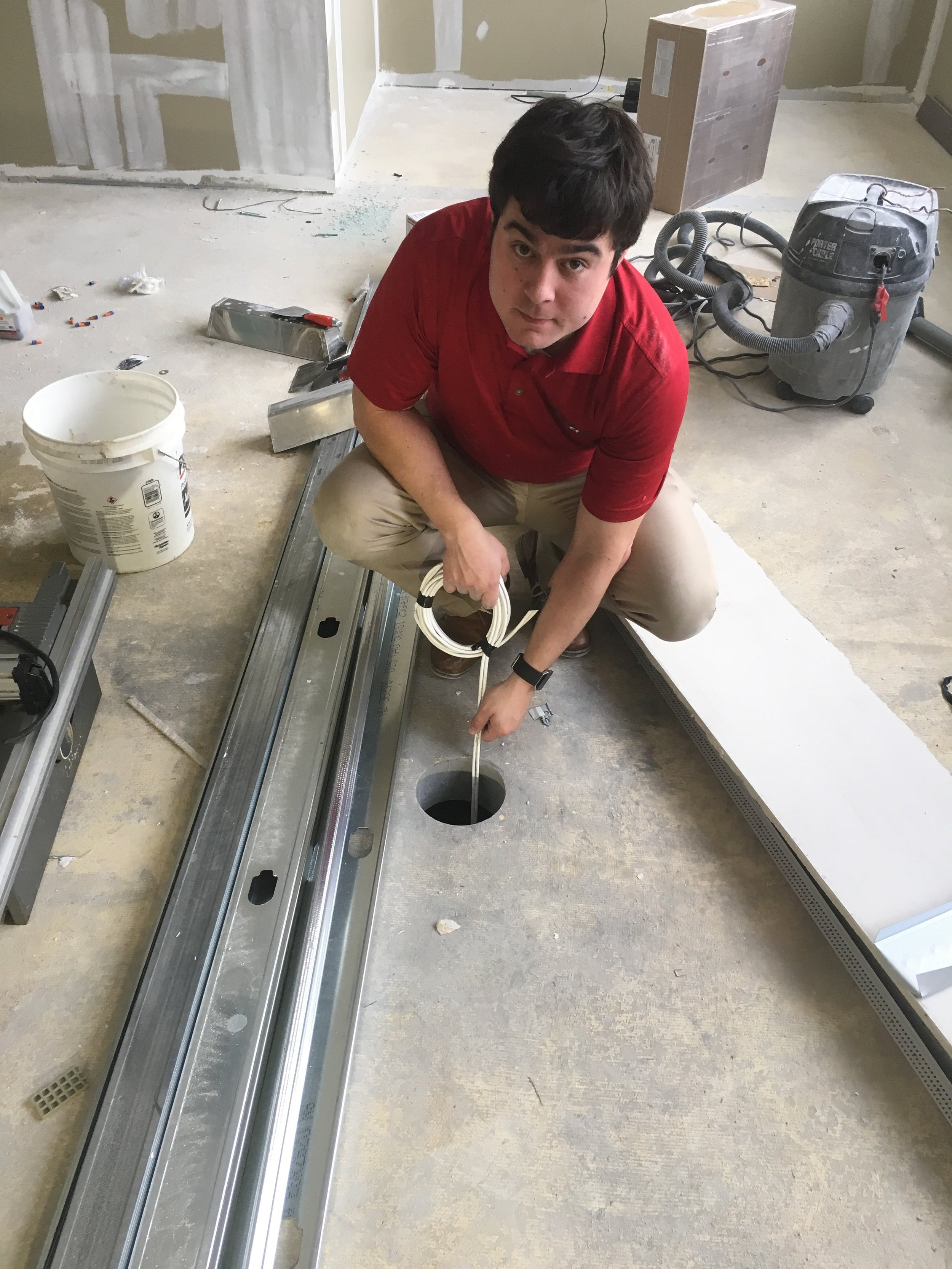 Our Service Manager, Ryan, running cat-6 cables for another client's office move. This one consisted of running wires through the ceiling, wall, and under the floor to be ready for a state-of-the-art conference table.