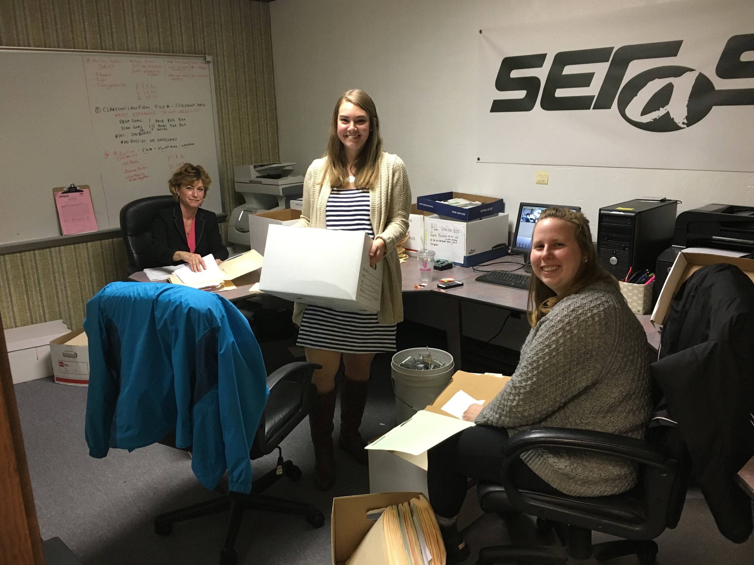 Cameron, Brianna, and Debbie;three of our great Scanning Technicians prepping files for scanning.