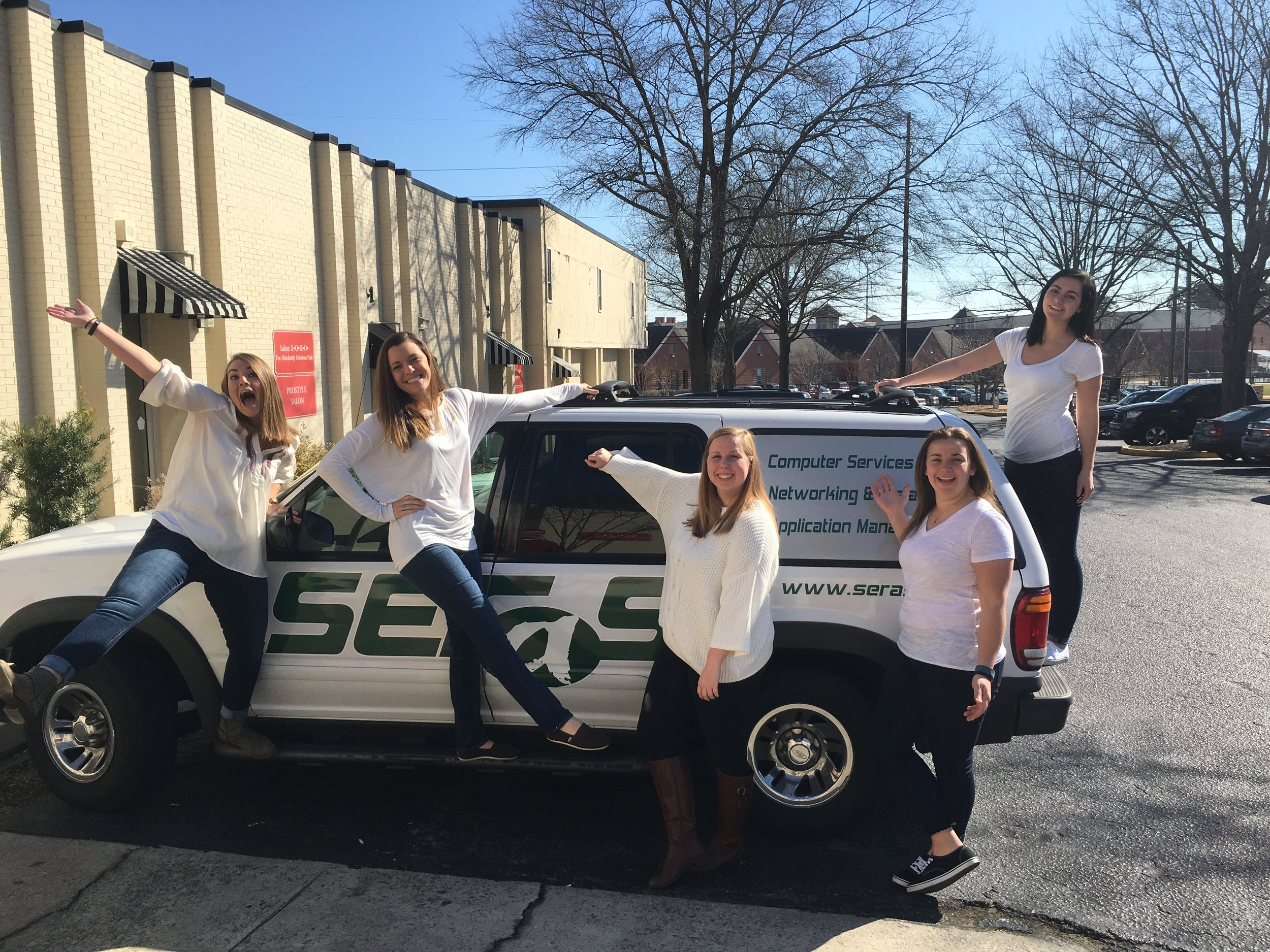 Some of our great Document Scanning Team posing in front of our Seras Vehicle.