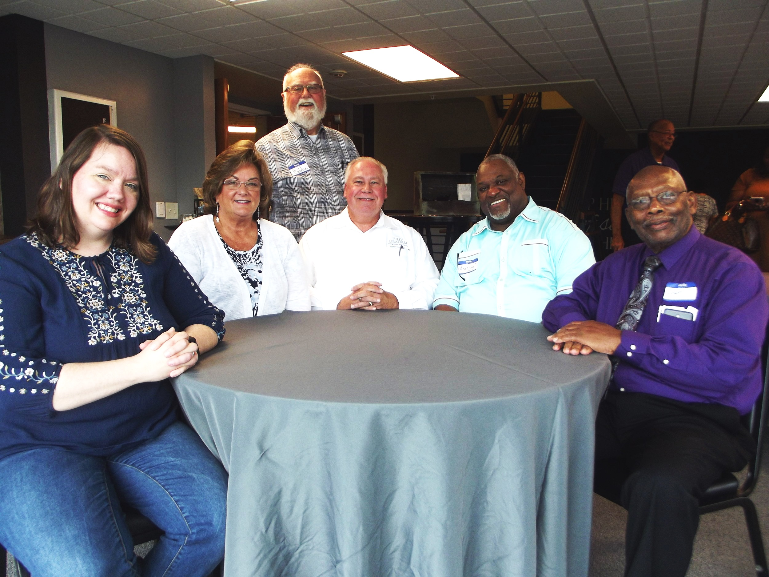 Left to Right: Rev. Haley Robinson, Kathy Martin. Rev. Garry Martin, Bishop Anthony Alfred, Dr. Anderson Grant, Standing: Pastor Bill Graham