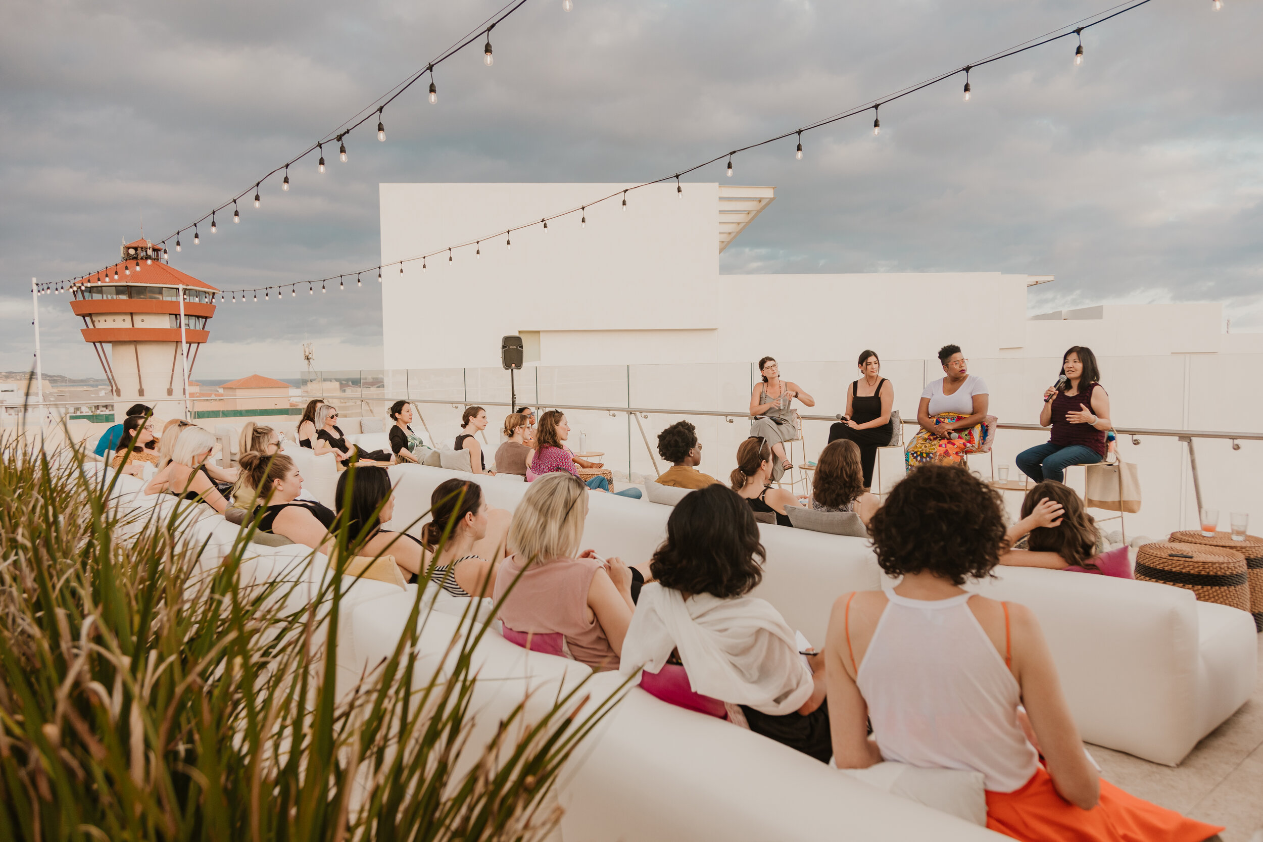 Women on panel on rooftop