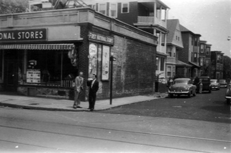 """Photograph courtesy of Sarah Ratta, who writes, """"This photo was taken circa 1954-1955 when my father Frank Ratta (the dark haired gentleman) returned from military service in Korea and Germany. He is standing on the corner of Hall and South Streets with a fellow serviceman and childhood friend, who grew up on Jamaica Street. I grew up at #24 Hall St, which is the fifth building down on the left."""""""
