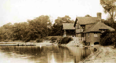 View of boat house at Jamaica Pond sometime before 1911. Image from photo postcard.