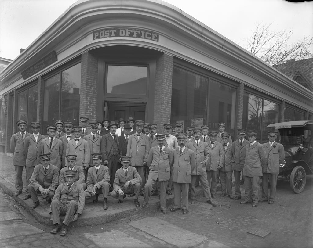 U.S. Post Office staff pose in front of the post office at the corner of Cheshire and Green Sts. Courtesy of Boston Public Library.