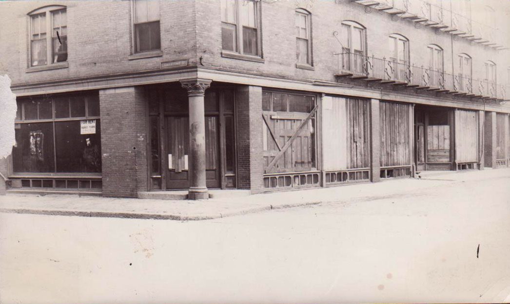 An early Jamaica Plain library, known as a deposit station since books were placed there on deposit for the public to borrow, is shown in this undated photograph. The branch opened at the corner of Lamartine and Paul Gore Streets in 1897. Photograph and caption information courtesy of Jane Bickford, Boston Public Library, Connolly Branch.
