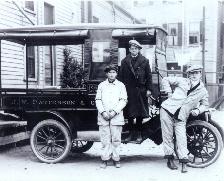 Joseph A. Patterson (middle) poses circa 1912 with two employees of Patterson's Market in the rear of 128 South St. Photograph provided courtesy of John Patterson. Thanks also to Peter O'Brien for arranging the donation of this image.  Download high-resolution image.