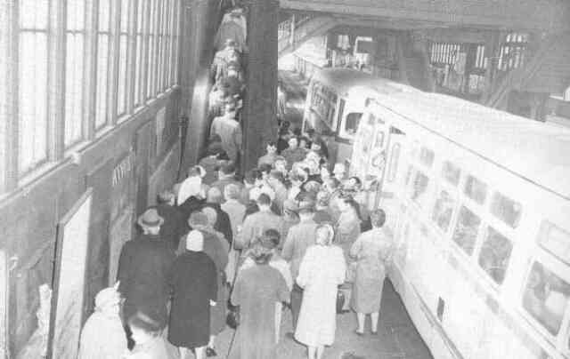 Buses unload passengers on the lower level of the Forest Hills Orange Line station in 1960. Courtesy of Anthony Sammarco.
