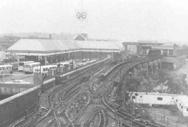 The newly opened Forest Hills Orange Line station is shown on the left in this 1987 photograph while the old station, being readied for demolition, is seen on the right.
