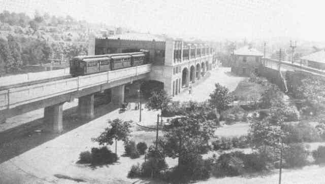 An elevated train leaves the newly completed Forest Hills station in 1908.