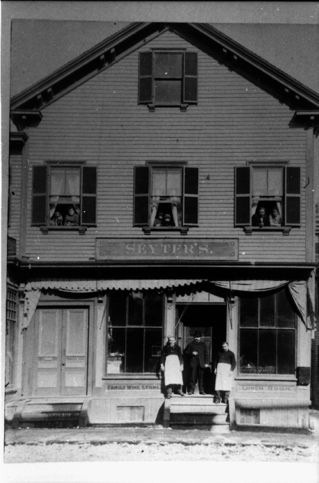 """Exterior of Seyter store located in the vicinity of Boylston Station, Jamaica Plain. The sign below the window on the left reads, """"Family Wine Store"""". Photograph courtesy of Emy Thomas. Higher resolution versions of photographs in this set are  available ."""