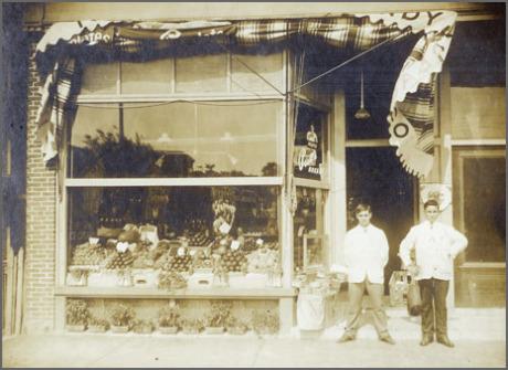 Bob Ristuccia (left) stands in front of Bob's Spa, 128 South Street, circa 1912.  Download  high resolution .tif file.